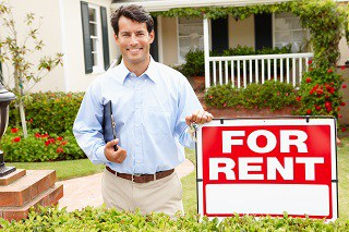 image of renter in front of house